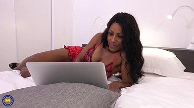 French black milf Mrs. Guyana in red lingerie flirts via webcam