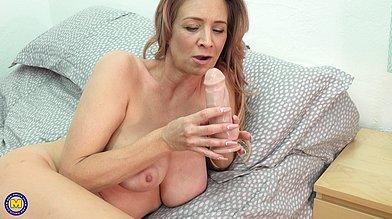 Beautiful American mature Jennifer Faucet talks dirty and teases