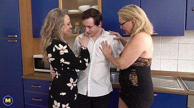Two mature sluts Andrea V and Lea seduce a shy guy