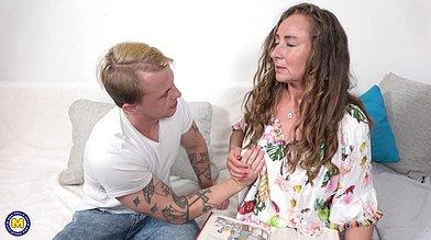 Tall cougar Majda seduces a young guy